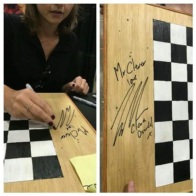 Jenna signing chessboard